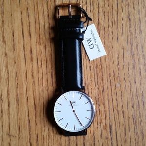 Daniel Wellinton -- 36mm gold case / black strap
